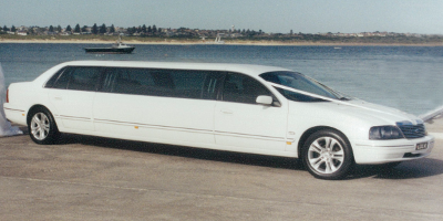 White Ford LTD Stretch Limo - Seats 8 (back) + 1 (front)